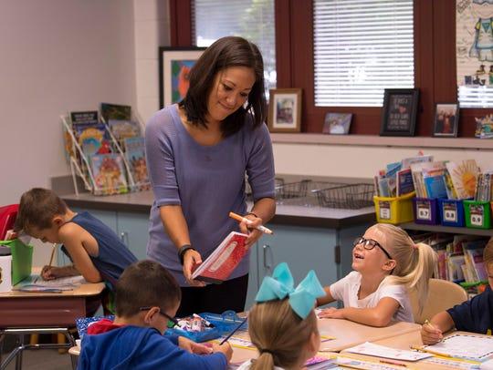 J.H. Castle first grade teacher Charlena Dan checks
