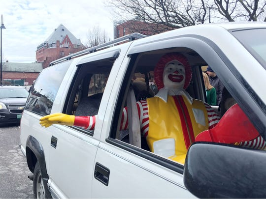 The Ronald McDonald statue sits in the front passenger