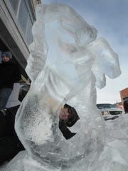 """Walt Ash of Carlsville works on his """"Hippocampus'' ice sculpture last year during Fire & Ice."""