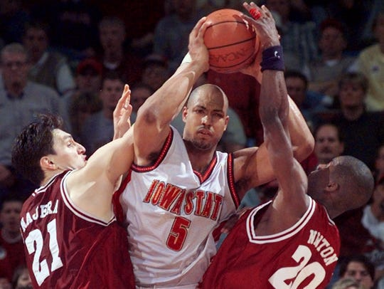Iowa State's Marcus Fizer fights to keep the ball on