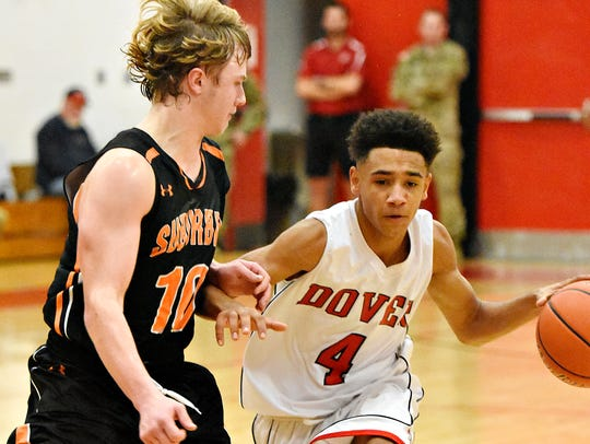 In this file photo, Dover's Keith Davis, right, looks to get around York Suburban's Collin Mailman, left, during boys basketball action at Dover Area High School in Dover, Pa. Davis, now a junior, returns as Dover's leading scorer from the 2016-17 season, when he averaged 17.1 points per game. (Dawn J. Sagert - The York Dispatch)