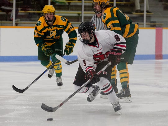 Stevens Point Area Senior High School freshman Cole Caufield shows some of his stickhandling skills during a Panthers nonconference game this past season.