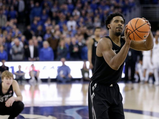 Xavier's J.P. Macura, left, watches as Quentin Goodin (3) shoots the winning point from the free-throw line after he was fouled by Creighton's Toby Hegner in the closing seconds of the second half of an NCAA college basketball game in Omaha, Neb., Saturday, Feb. 10, 2018. Xavier won 72-71. (AP Photo/Nati Harnik)