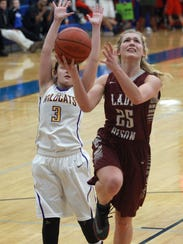 Station Camp's Emiline Payne drives to the hoop late