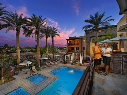 Bill and Patricia O'Dell enjoy the evening on the balcony of the clubhouse at Sage Scottsdale on  Sunday, April 12, 2015.