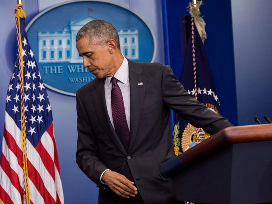 President Obama leaves the podium after speaking on