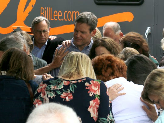 Bill Lee stands with wife Maria on Monday in Franklin as dozens of friends pray for the couple before they travel across Tennessee to campaign for governor.