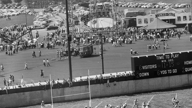 The Baltimore Colts played the Philadelphia Eagles at the newly opened Kentucky fairgrounds, while the state fair took place in the background.  By Al Blunk, The Courier-Journal.  Sept. 9 1956
