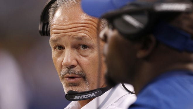 Indianapolis Colts head coach Chuck Pagano looks to Robert Mathis for help in the first half of their preseason football game Thursday, August 31, 2017.