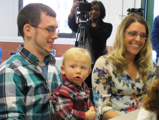 Bryan Taft and Anna Paul of Elmira finalized the adoption