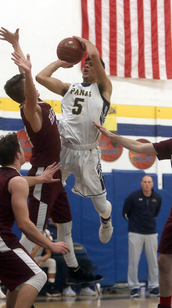 Brandon Ramos of Walter Panas drives against Harrison
