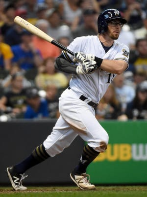 Brewers second baseman Eric Sogard hits a double in the seventh inning during a game against the Pittsburgh Pirates at Miller Park.