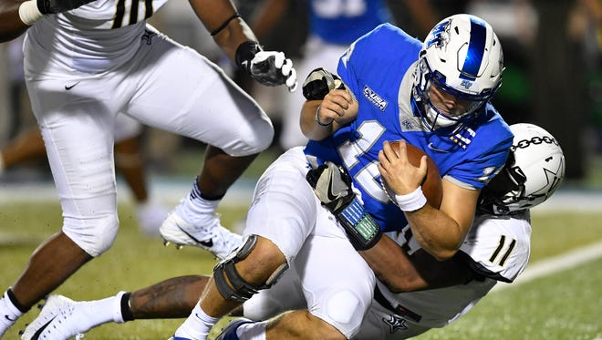"Vanderbilt linebacker Charles Wright (11) sacks Middle Tennessee quarterback Brent Stockstill (12) during the second half of an NCAA college football game at Johnny ""Red"" Floyd Stadium in Murfreesboro, Tenn., Saturday, Sept. 2, 2017."