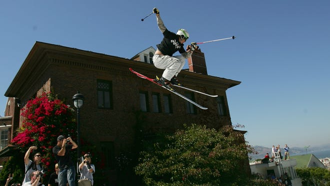 SAN FRANCISCO - SEPTEMBER 29:  Jonny Moseley launches off the jump during a promotional ski jump put on by Icer Air on Filmore Street on September 29th, 2005 in San Francisco, California.  (Photo by Jed Jacobsohn/Getty Images)