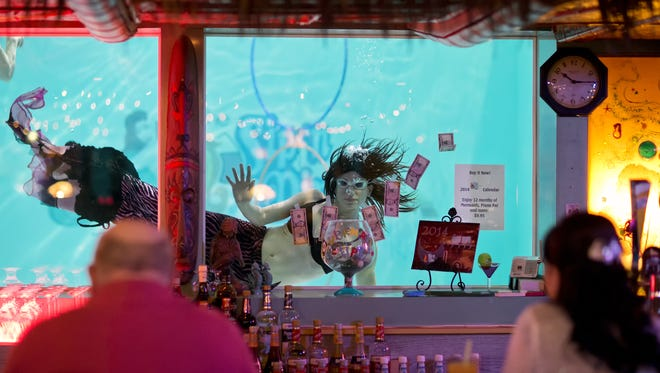 A mermaid swims at the Sip 'N Dip located at the O'Haire Motor Inn.