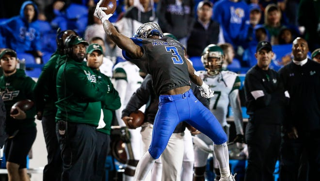 University of Memphis receiver Anthony Miller makes a one-handed catch against University of South Florida during third quarter action at the Liberty Bowl Memorial Stadium.
