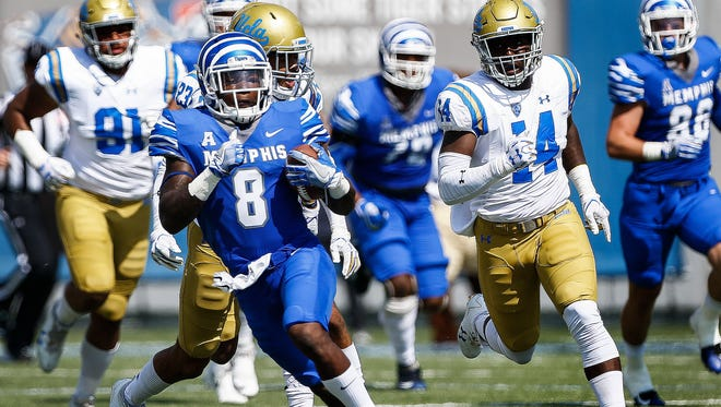 Memphis running back Darrell Henderson (8) scrambles past the UCLA defense during the first quarter Sept. 16, 2017, at Liberty Bowl Memorial Stadium.