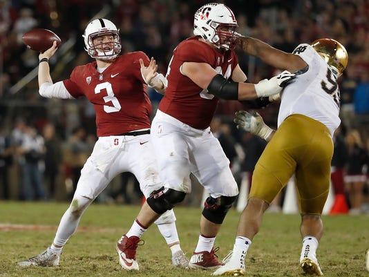 Stanford quarterback K.J. Costello (3) throws a pass against Notre Dame during the second half of an NCAA college football game Saturday, Nov. 25, 2017, in Stanford, Calif. Stanford won 38-20. (AP Photo/Tony Avelar)