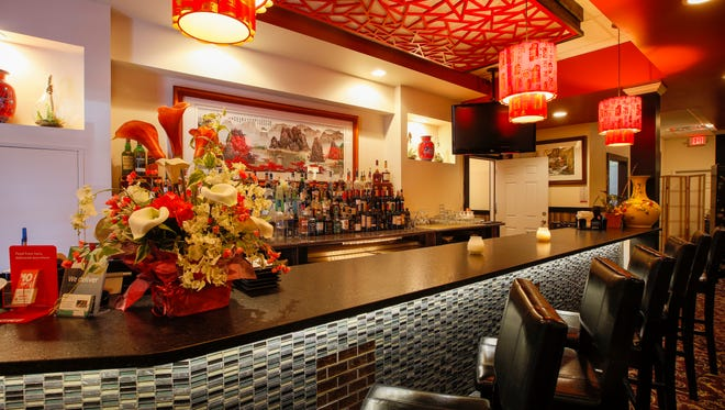 A bar area is an inviting spot inside Red Sun, 2775 Monroe Ave, Brighton.