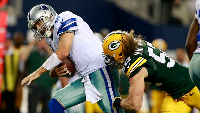 Dallas Cowboys quarterback Tony Romo (9) is sacked by Green Bay Packers linebacker Clay Matthews during last year's game.