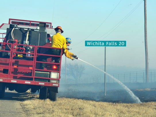 Units from several area fire departments work to contain a grass fire that broke out near Electra on Farm-to-Market Road 367 near Highway 25 Monday afternoon.