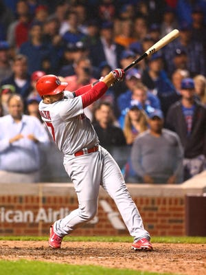 St. Louis Cardinals shortstop Jhonny Peralta hits a two run home run in the ninth inning against the Chicago Cubs at Wrigley Field.