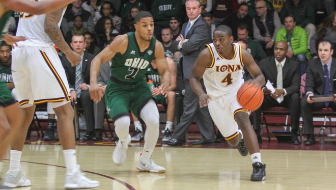 Iona's Schadrac Casimir is defended by Ohio University's Jaaron Simmons during an NCAA men's basketball game against Ohio University at the Hynes Athletic Center in New Rochelle, New York on Dec. 10, 2016.