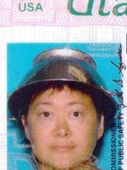 Asia Lemmon, whose legal name appears on her driver's license as Jessica Steinhauser, wears a metal colander on her head for her Utah driver's license.