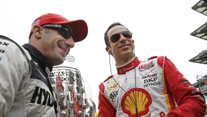 Tony Kanaan and Helio Castroneves talk before the race next to the Borg Warner trophy. Tony Kanaan won the 97th running of the Indianapolis 500 at the Indianapolis Motor Speedway in Indianapolis, IN Sunday, May 26, 2013.