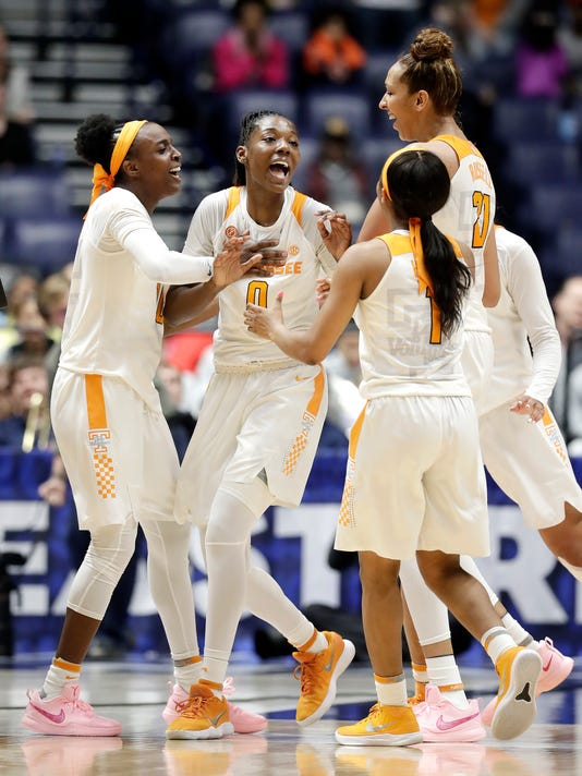 Tennessee's Rennia Davis (0) celebrates with teammates after shooting the winning three-point basket against Auburn with one second remaining in the fourth quarter of an NCAA college basketball game at the women's Southeastern Conference tournament Thursday, March 1, 2018, in Nashville, Tenn. (AP Photo/Mark Humphrey)
