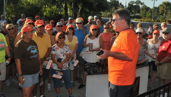FLORIDA TODAY Executive Editor Bob Gabordi talks with walkers before a walk at the Brevard Zoo.