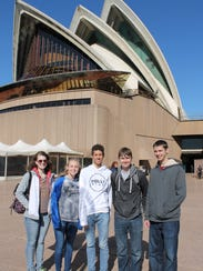The team in Australia at the Sydney Opera house. Students