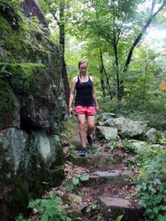 Courtney Lewis hikes down the rugged Eagle Peak Trail