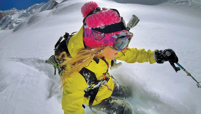 This photo shows the GoPro digital camera mounted on a ski helmet. Several potential Olympians are using the camera on their practice runs to help them improve.