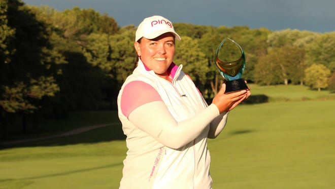 Winner Laura Gonzalez Escallon poses with the PHC Classic trophy at Brown Deer Park Golf Course.