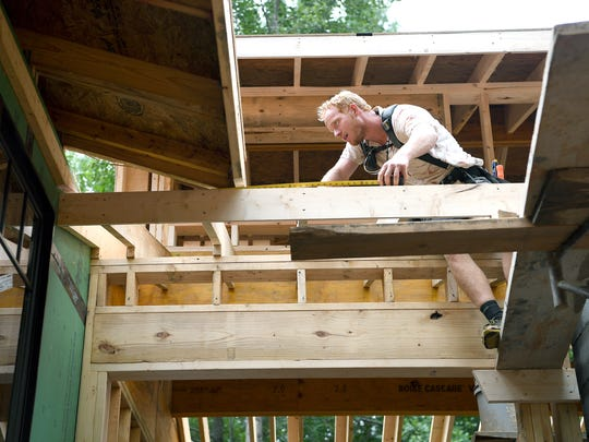 Patrick Smith does roofing work with Integrity Construction