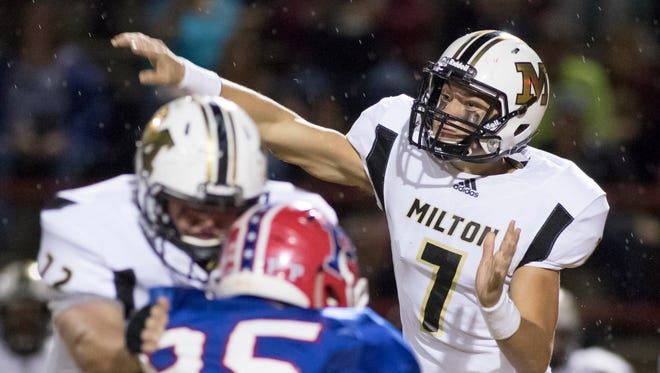 Panther quarterback Aubrey Williams (7) passes during the Milton vs Pace football game at Pace High School on Friday, October 27, 2017.
