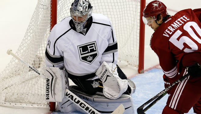 Los Angeles Kings goalie Martin Jones makes the save on Arizona Coyotes center Antoine Vermette (50) in the second period on Thursday, Dec. 4, 2014, in Glendale.