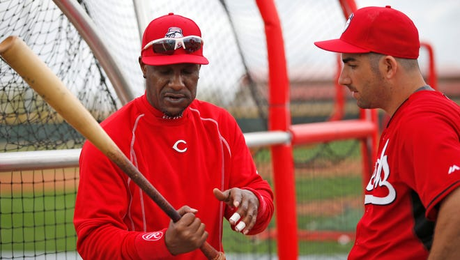 Special assistant to the general manager Eric Davis, left, works with non-roster invitee pitcher Josh Satin at spring training.