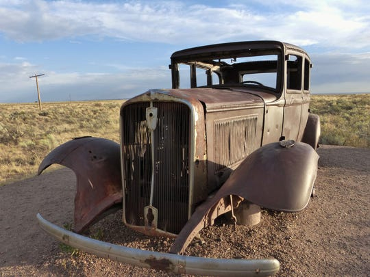 An old car still sits on the edge of Petrified Forest National Park, the only national park crossed by Route 66.