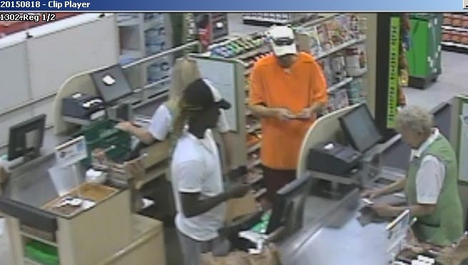 Deputies say the man in the white shirt appears to have used a cloned credit card to put $164 of items at the Publix on Summerlin Road.