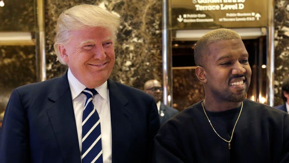 Donald Trump and Kanye West pose for a picture in the