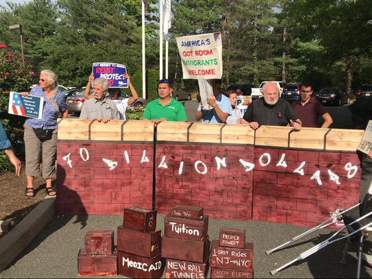 Residents protest Rep. Josh Gottheimer's recent vote in favor of a security spending package that included a $1.57 billion allocation for President Donald Trump's proposed wall along  the U.S. border with Mexico.