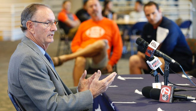 UTEP athletic director Bob Stull, left, speaks Monday about plans to name an interim football coach.