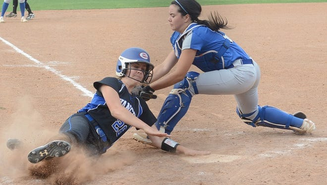 Evangel's Claire McMillian slides into home against DeRidder. The Lady Eagles are headed to Sulphur for the state softball tournament.