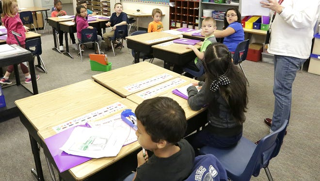 Riverside Elementary School teacher Billie Tighe teaches her first grade class Friday. State report cards released last week show Fond du Lac School District exceeded expectations, earning a 4-star rating.