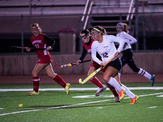 Gettysburg's Kailey Mixell battles with Susquehannock players for the ball during the District 3 field hockey doubleheader at Bermudian Springs High School on Oct. 26, 2016.