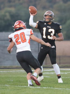 River View quarterback Keith Stewart throws a pass against Meadowbrook last week. The Black Bears host Marietta on Friday, while Ridgewood welcomes Garaway and Coshocton entertains Philo in area action.