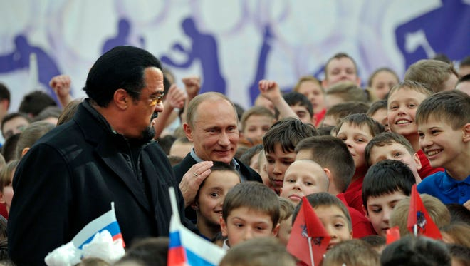 Steven Seagal, left, and Russian President Vladimir Putin visit a new sports arena in Moscow on March 13, 2013.