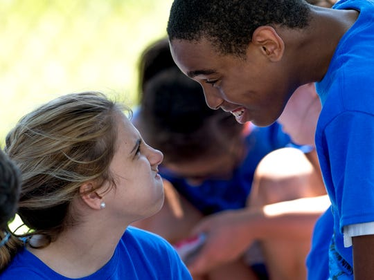 Helfrich Park Middle School students Emilee Cheshire, 15, left, and Sincere Brown, 12, entertain themselves during lunch at the United Champions Special Olympics meet at Central High School Tuesday morning.